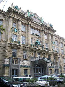 10-...of this building on Andrassy Blvd, where—over the entrance canopy—you see...