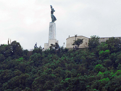 48-The 14-meter high Freedom Monument (originally liberation monument, 1945) below Citadella, atop Gellert Hill. A woman holds a palm (originally an aircraft propeller) above her head.