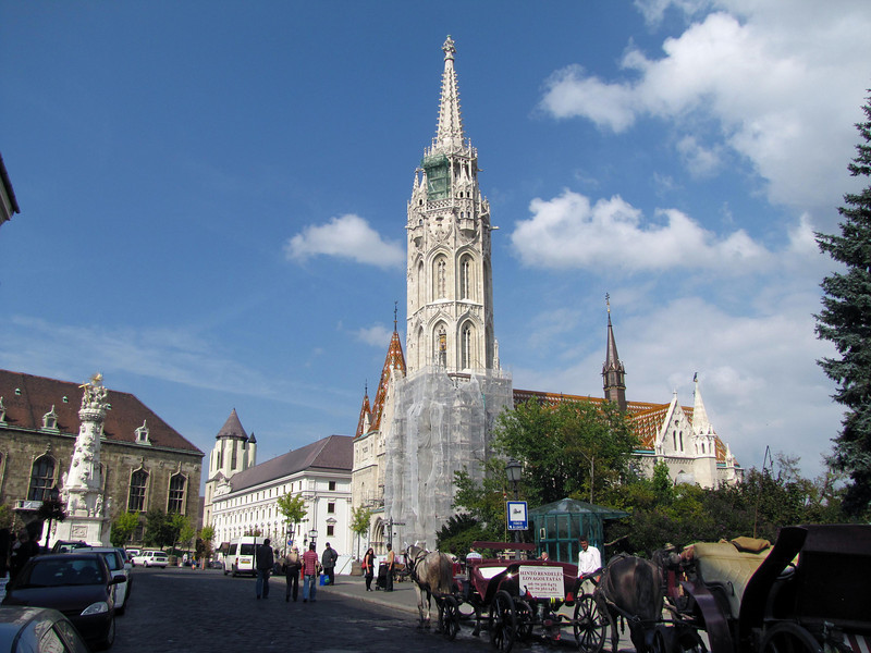 """25-Holy Trinity statue and square, Mátyás Church. Officially """"Church of Our Lady,"""" its popular name is after Good King Mátyás who ordered construction the original southern tower."""