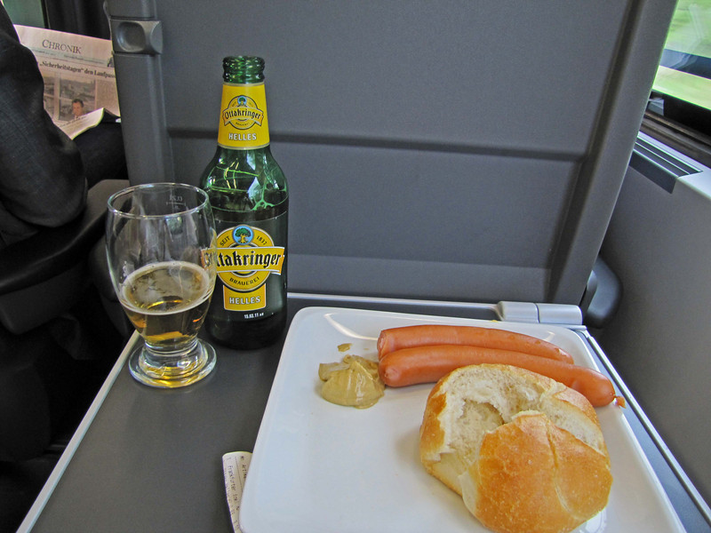 30 minutes out of Budapest, lunchtime on the Railjet: My choice from the menu was frankfurter wurstels, mustard, bun, and Helles beer.