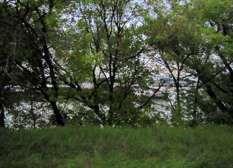 Barges on the Danube (look betwenn the trees); 1:05 west of Budapest