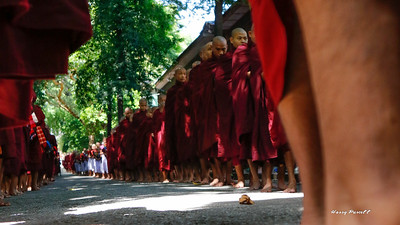 monks line up for the daily alms