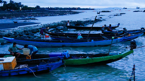 fishermen return to the Sittwe market at dawn