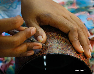 carving a design in a lacquer bowl