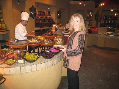 "Part of the buffet at Al Hadheerah.  I love those pink pickled radishes.  The top I'm wearing is a Palestinian design that I bought when I was in Salalah (in Oman).  Yeah I know, I can hear 'certain people' doing their poncy voices: ""Air hair lair.  When I was in Sidi Birahhni dahling...."""