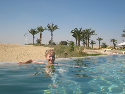 In the pool with the desert and palm trees in the background - quite surreal.