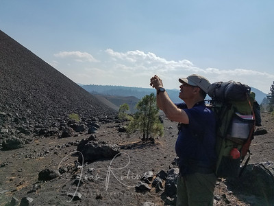 Charles taking a photo of Cinder Cone as we pass by.