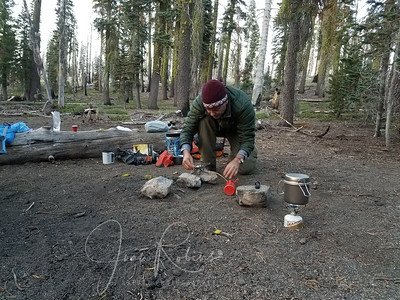 After setting up both our tents, Charles starts cooking dinner.