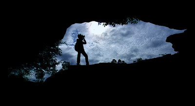 Contours of a natural bridge we came upon in a trek. One of the fellow photographers graciously poses.