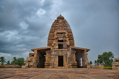 The wonderful Virupaksha Temple in Pattadakal.  You can see the pouring rain, due monsoon, in which this was shot! There are also the beginnings of a rainbow at the corner-top-left and corner-top-right of the picture. Had to take cover as the clouds opened up in a fury!