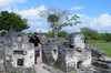 The ruins at Kaole, about 5 km south of Bagamoyo, date back to a period between the 13th and 16th centuries. The ancient Muslim settlement features two mosques and several dozen tombs. Here a tour guide stands between two tombs.