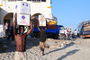 "Young men unload goods that arrived by ship early one morning near the old port of Bagamoyo. The current President of Tanzania, Jakaya Kikwete, has announced <a href=""http://www.jkikwete.com/news.php?id=949"">plans</a> to build a port at Mbegani, Bagamoyo District, to help relieve pressure on the port facilities in Dar es Salaam."