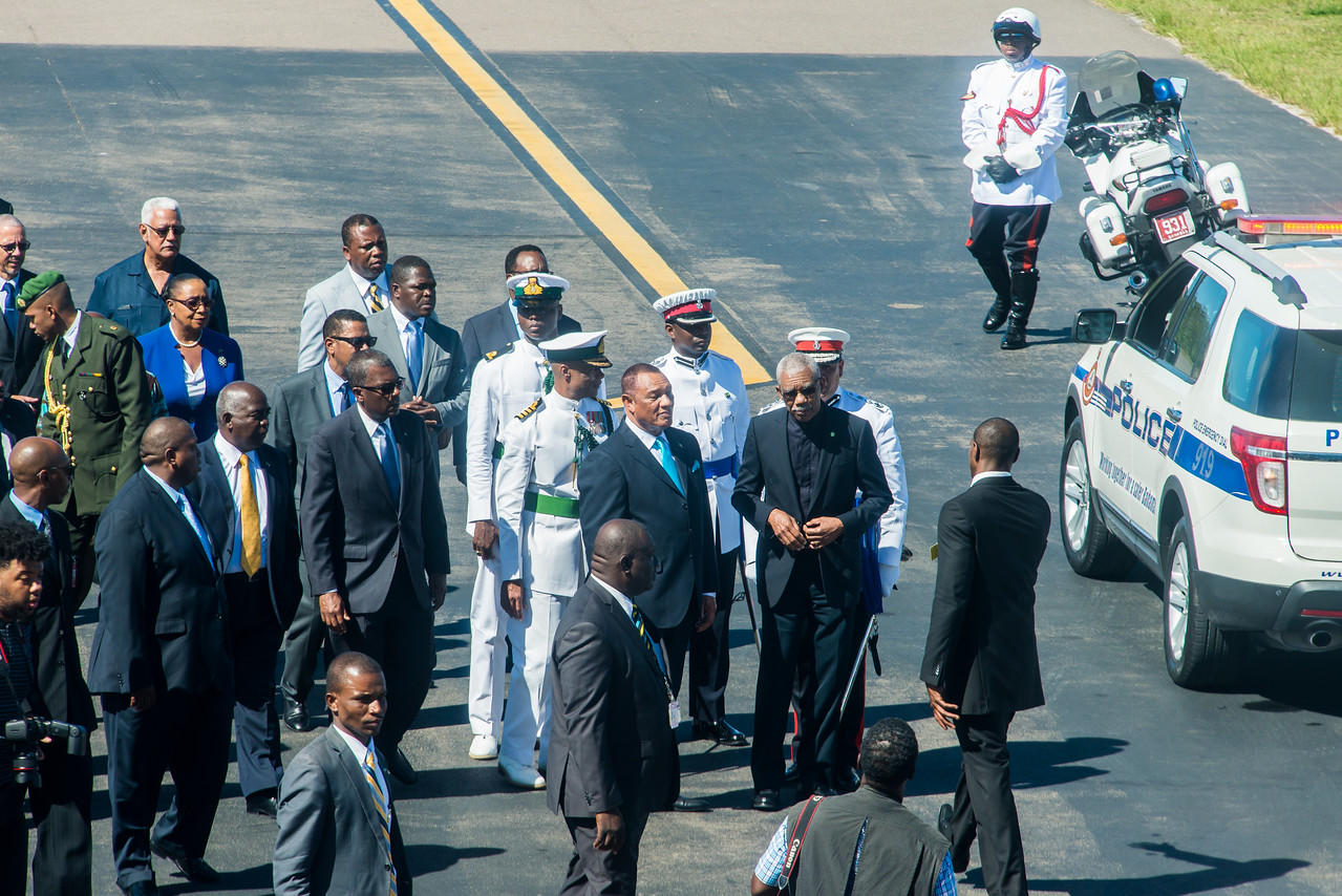 Prime Minister of Bahamas (Perry Christie in blue tie) formally greets the President of Guyana (David A. Granger in black tie) meet at the Nassau Airport.  March 2, 2017.