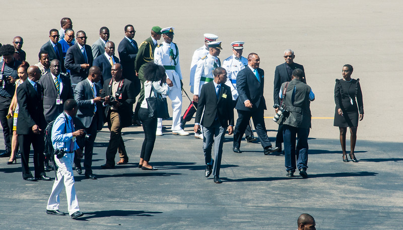 Prime Minister of Bahamas (Perry Christie in blue tie) walks with the President of Guyana (David A. Granger in black tie) meet at the Nassau Airport.  March 2, 2017.