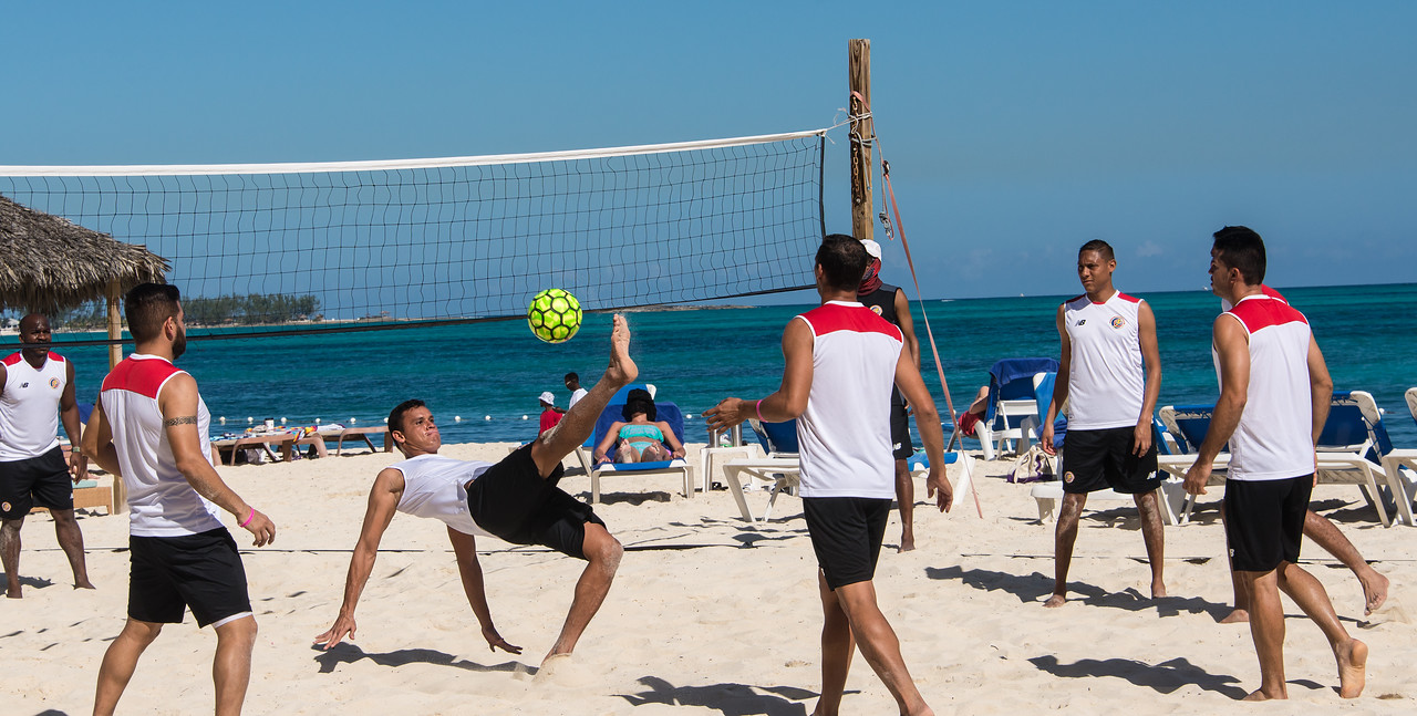 Professional beach soccer players playing volleyball with only heads and feet!