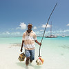 Johnny Viagra retrieving conch stored in the ocean on Stocking Island