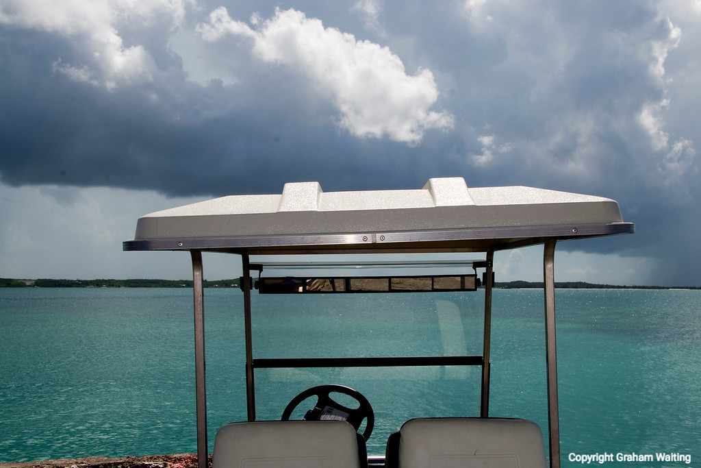 Golf cart overlooking ocean