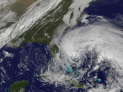 In this satellite image provided Friday, Oct 26 by the National Oceanic and Atmospheric Administration, Hurricane Sandy's huge cloud extent of up to 2,000 miles churns over the Bahamas, as a line of clouds associated with a powerful cold front approaches the East Coast of the U.S.