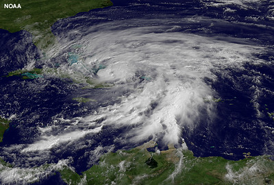 Hurricane Sandy's huge cloud extent of up to 2,000 miles churns over the Bahamas, with the eye of the storm seen well in this image.