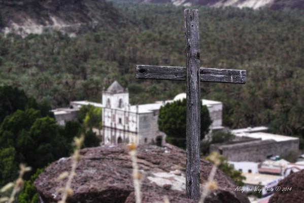 San Ignacio Cross 5510<br /> Old Wooden cross on top of a hill overlooking San Ignacio Mission in Baja California.