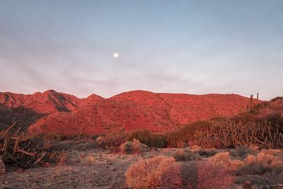 A hike at dawn, under a setting full moon.