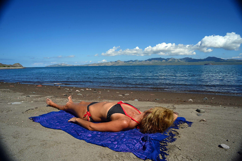 women have a very special connection to the sun - add sand and they immediately undress