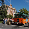 The Old Town trolley stops for riders at the House of Hospitality  at Balboa Park, in San Diego.