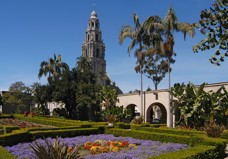 The California Tower rises above beautiful Alcazar garden in Balboa Park, San Diego.