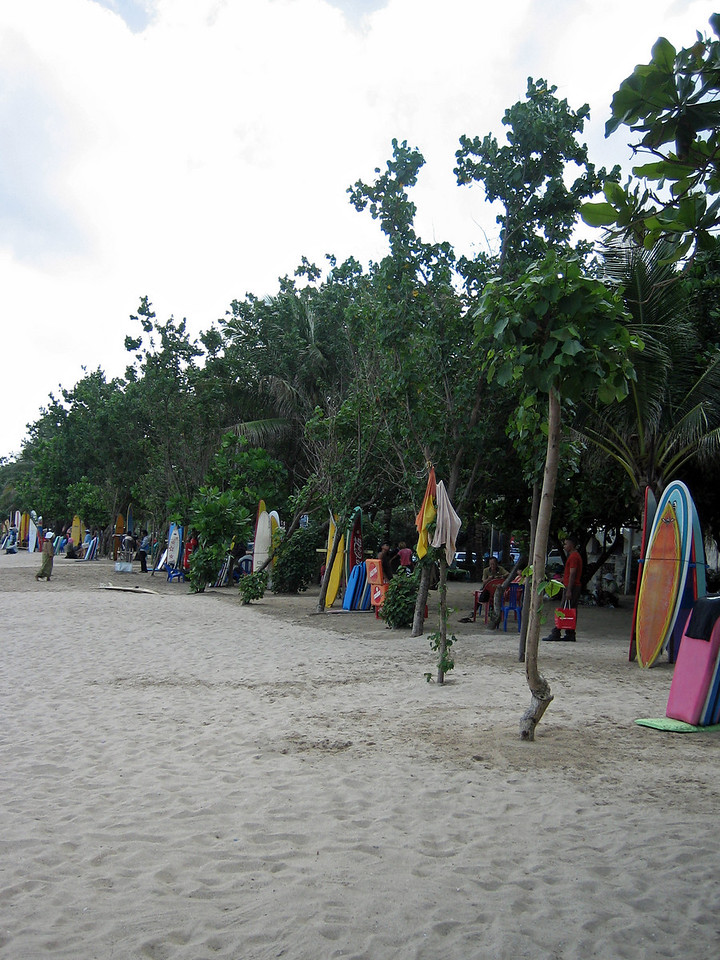 Surf's up on Kuta beach!  Professional surfers from around the world come to Bali in the summer to surf.