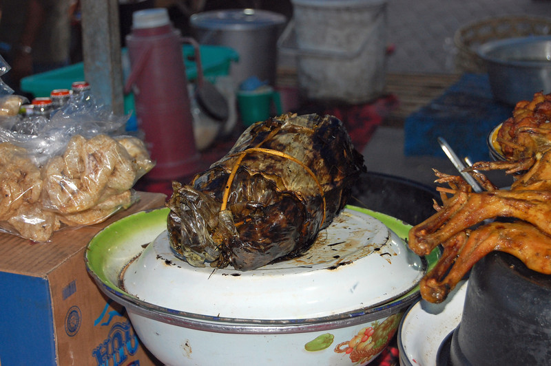 Ayem betutu, our second favorite meal. Chicken stuffed with spices, wrapped in coconut bark & banana leaves, cooked all day.....