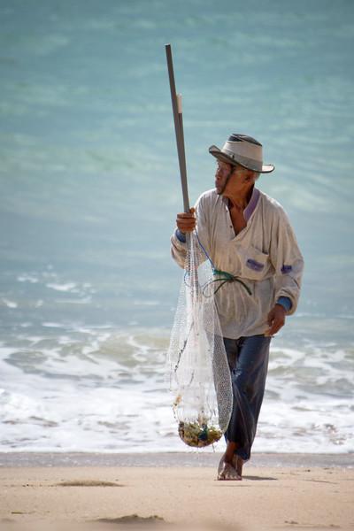 An elderly fisherman at Jimbaran Beach.