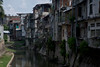 Homes stacked hard against the Sungai Badung river in Denpasar.