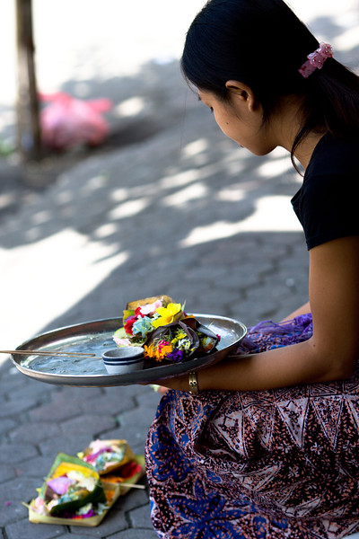 A shopkeeper in Legian puts out her offerings.