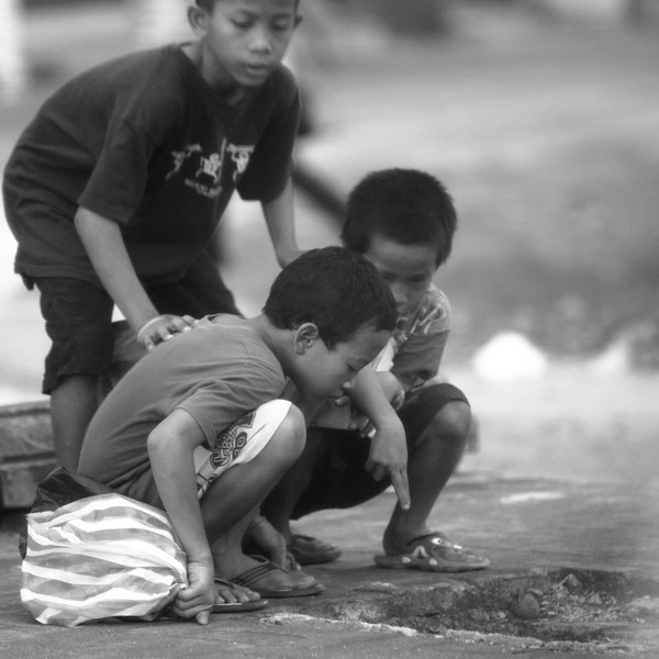 Distracted kids near Kuta.