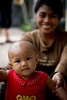 A mother proudly shows me her baby in Ubud.