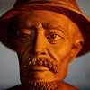 Rice farmer carved from hibiscus wood.