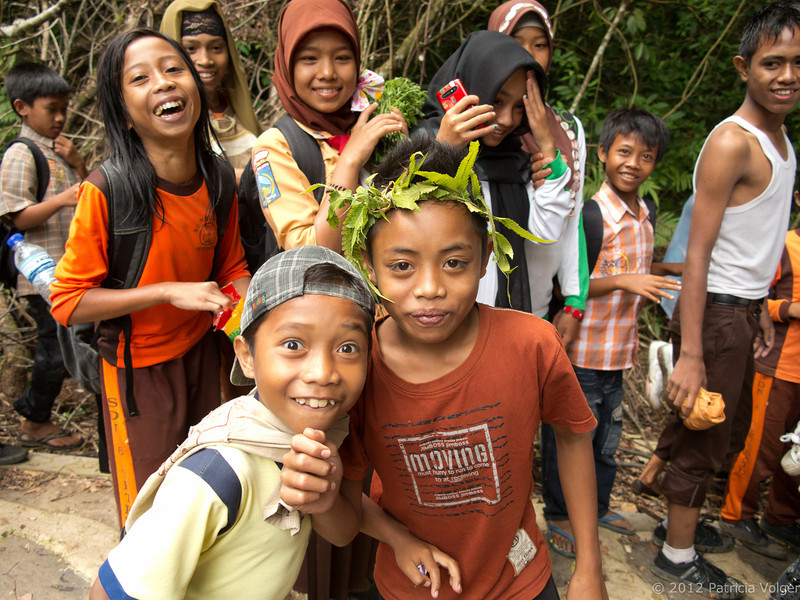 local children on their Sunday scout trip to the waterfall, Lombok, Indonesia