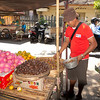 Gede picking out mangosteen for all of us to try. at the local market in Singaraja, Northern Bali