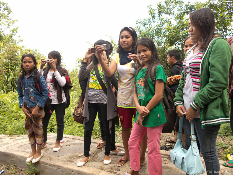 these kids don't see westerners too often, so the all pulled out their phones and took pictures of us, Lombok, Indonesia