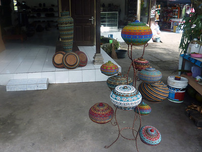 On the short walk into the center of Ubud we passed this place where they made and sold beaded baskets.