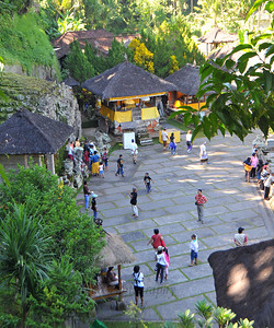 View from the top of Goa Gajah. Elephant Cave, is located on the island of Bali near Ubud and a short distance from Bedulu. Built in the 9th century, it served as a sanctuary. A carved entrance depicts entangling leaves, rocks, animals, ocean waves and demonic human shapes running from the gaping mouth which forms the entrance to the cave. The facade of the cave is a relief of various menacing creatures and demons carved right into the rock at the cave entrance. The primary figure was once thought to be an elephant, hence the nickname Elephant Cave. The site is mentioned in the Javanese poem Desawarnana written in 1365. Inside the cave one finds the Shiva lingum.  The monstrous Kala head that looms above the entrance seems to part the rock with her hands. Similarly decorated hermit cells are also found in Java. The large earrings indicate that the figure is that of a woman. The T-shaped interior of the rock-hewn cave contained niches which probably served as compartments for ascetics.  Goa Gajah is named after Sungai Petanu (Elephant River not an elephant as elephants are not found in Bali) and dates back to the 11th Century where it originally served as a dwelling for Hindu priests. Outside the cave at the pavilion is a statue of Men Brayut, the Balinese woman who together with her husband Pan could not stop having kids. The legend of Men Brayut is also represented in local Buddhist writings, under the name of Hariti, indicating a possible Buddhist association with Goa Gajah as well as Hindu.  Outside the cave, an extensive bathing place on the site was not excavated until the 1950s. These appear to have been built to ward off evil spirits. It is an UNESCO World Heritage site.