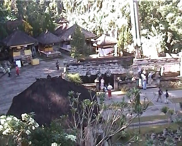 Short video clip of Goa Gajah by Arundhathi (Anu).  Goa Gajah or Elephant Cave which is located on the island of Bali near Ubud and a short distance from Bedulu. Built in the 9th century, it served as a sanctuary. A carved entrance depicts entangling leaves, rocks, animals, ocean waves and demonic human shapes running from the gaping mouth which forms the entrance to the cave. The facade of the cave is a relief of various menacing creatures and demons carved right into the rock at the cave entrance. The primary figure was once thought to be an elephant, hence the nickname Elephant Cave. The site is mentioned in the Javanese poem Desawarnana written in 1365. Inside the cave one finds the Shiva lingum.