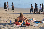 Couple relaxing on Kuta Beach.Kuta District (Indonesian: Kecamatan Kuta) is administratively a district (Kecematan) and subdistrict/village (Kelurahan) in southern Bali, Indonesia. Althoug ...