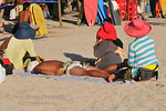 Vendors on the beach can be quite annoying. Selling from drinks to clothing to a massage on the beach.Kuta District (Indonesian: Kecamatan Kuta) is administratively a district (Kecematan) a ...