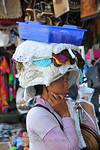Ladies selling clothing balanced on their head.In Central-East of Bali is Sukawati. In the the centre of town is the renowned Pasar Seni, undoubtedly the best place to shop in Bali. The two ...