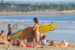 Surfing is still very popular on Kuta Beach.Kuta District (Indonesian: Kecamatan Kuta) is administratively a district (Kecematan) and subdistrict/village (Kelurahan) in southern Bali, Indo ...