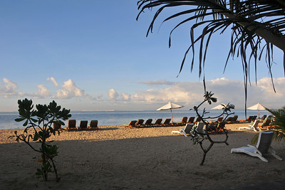 Some nice resorts & hotels line the beach front at Sanur. Sunrise at Sanur Beach - Sanur (Indonesian: Pantai Sanur Pronounced: Sah-Noor) is a coastal stretch of beach of Denpasar city located in South East of Bali. Its about a 30 minutes drive from Ngurah Rai International Airport. Those wanting to avoid the mad-crowds of Kuta prefer Sanur beach which has grown into a little town in its own right. It contains a number of resorts and is a popular tourist destination. lessed with reef bed aquatics and various kinds of marine organism, Sanur is the second best diving spot in Bali after Tulamben. Its moderate wind and transparent water surely provides water sport enthusiasts with a playground of the first degree in terms of quality and safety. It also has a wide variety of restaurants, cafes, shops and nightlife.
