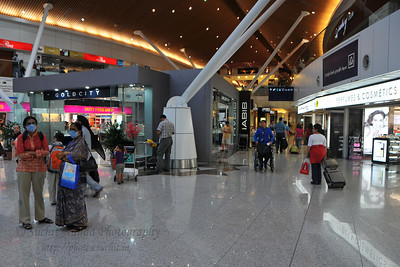 Due to Swine Flue alert a number of passengers had face masks.  Malaysia's swanky KLIA - Kuala Lumpur International Airport in KL, Malaysia as seen on our way back to India.