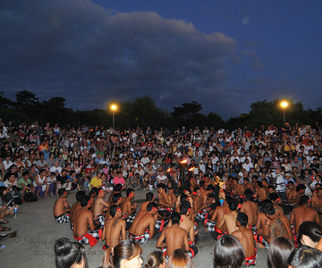 """Kecak Dance (also called """"monkey dance"""") being performaned at Uluwatu.  This dance is held at the temple daily between 6 pm and 7 pm. This show was invented for and performed for tourists and can be followed up with a dinner.  Pura Luhur Uluwatu, Bali.  Pura Luhur Uluwatu is one of Bali's kayangan jagat (directional temples) and guards Bali from evil spirits from the south-west. Major Hindu deities dwell in Uluwatu such as - Bhatara Rudra, God of the elements and of cosmic force majeures. Bali's most spectacular temples located high on a cliff top at the edge of a plateau 250 feet above the waves of the Indian Ocean. Uluwatu lies at the southern tip of Bali in Badung Regency. Dedicated to the spirits of the sea, the famous Pura Luhur Uluwatu temple is an architectural wonder in black coral rock, beautifully designed with spectacular views. This is a popular place to enjoy the sunset. Famous not only for its unique position, Uluwatu also boasts one of the oldest temples in Bali, Pura Uluwatu. Most of Bali's regencies have Pura Luhur (literally high temples or ascension temples) which become the focus for massive pilgrimages during three or five day odalan anniversaries. The photogenic Tanah Lot and the Bat Cave temple, Goa Lawah, are also Pura Luhur. Not all Pura Luhur are on the coast, however but all have inspiring locations, overlooking large bodies of water.  Uluwatu is a small village on the west coast, south of Jimbaran, but for most visitors it refers only to the famous temple of the same name and several kilometers further south at the coast. A taxi from Kuta to Uluwatu takes about 30 minutes up and down winding roads.  The temple is inhabited by large number of monkeys, who are extremely adept at snatching visitors' belonging, including bags, cameras and eyeglasses. One has to keep a very close grip on all your belongings. Anu carried a stick like some others and I carried my tripod. :) If you do have something taken, the monkeys can usually be induced to ex"""