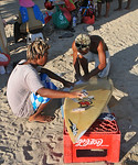 Fixing the surf boards. Kuta District (Indonesian: Kecamatan Kuta) is administratively a district (Kecematan) and subdistrict/village (Kelurahan) in southern Bali, Indonesia. Although popula ...